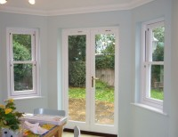 Before adding Roman blinds to french doors